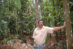 Narendra on his farm full of trees