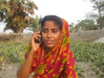 A woman calling the Krishi Call Centre seeking solution for her field problem
