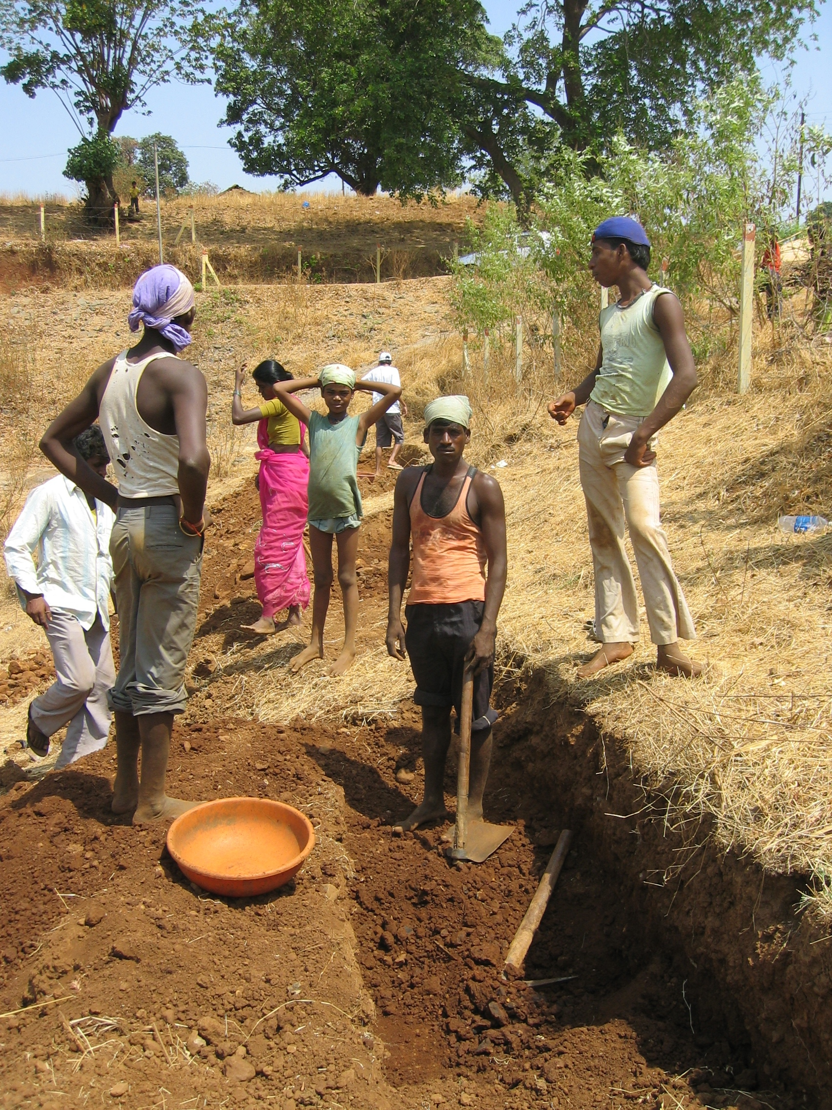 Digging of trenches along contour lines