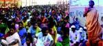 Adivasi woman addressing farmers gathering