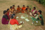 Woman, trained as paralegal, facilitates sangha meeting