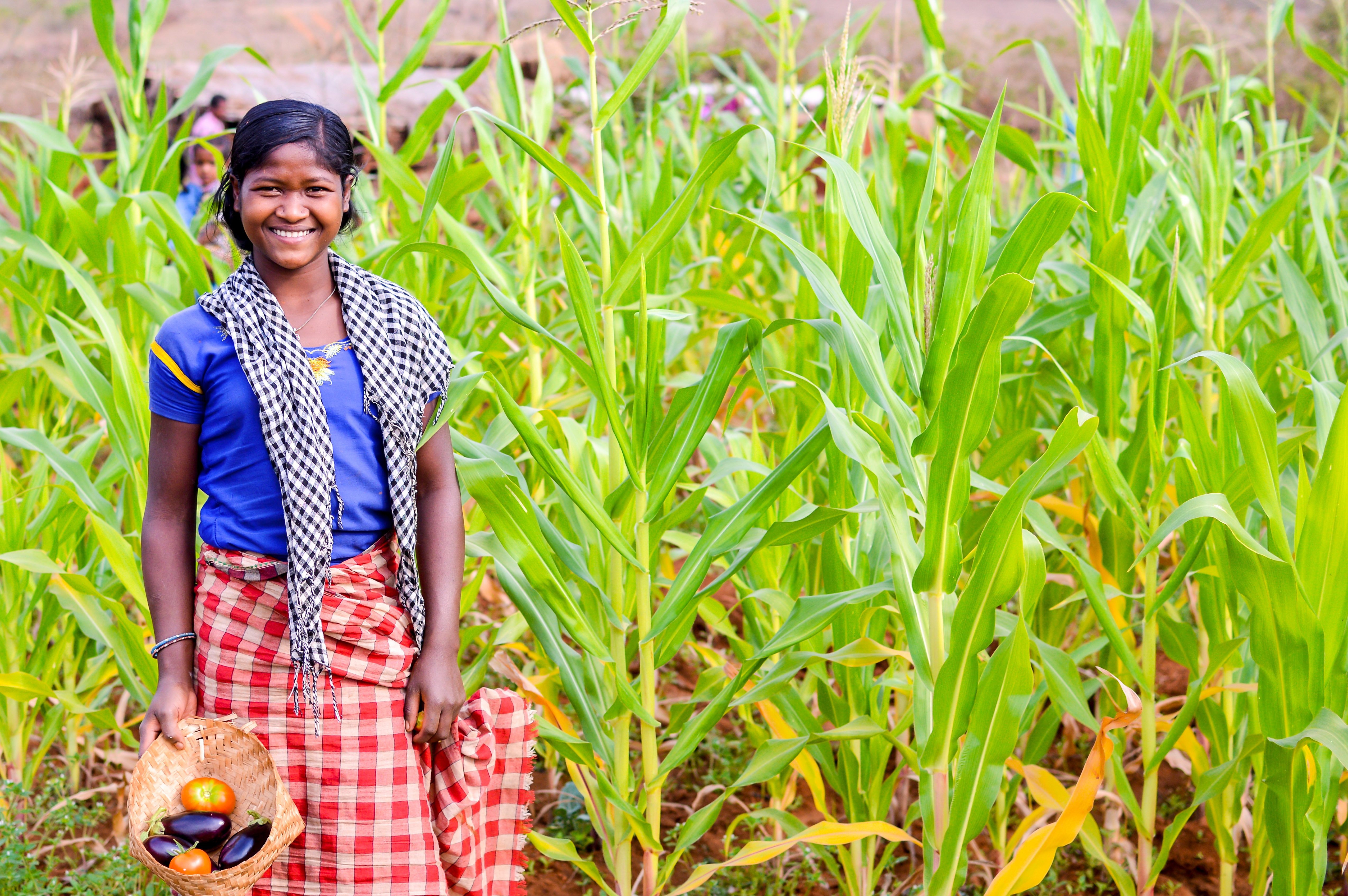 A girl happy to harvest diverse crops