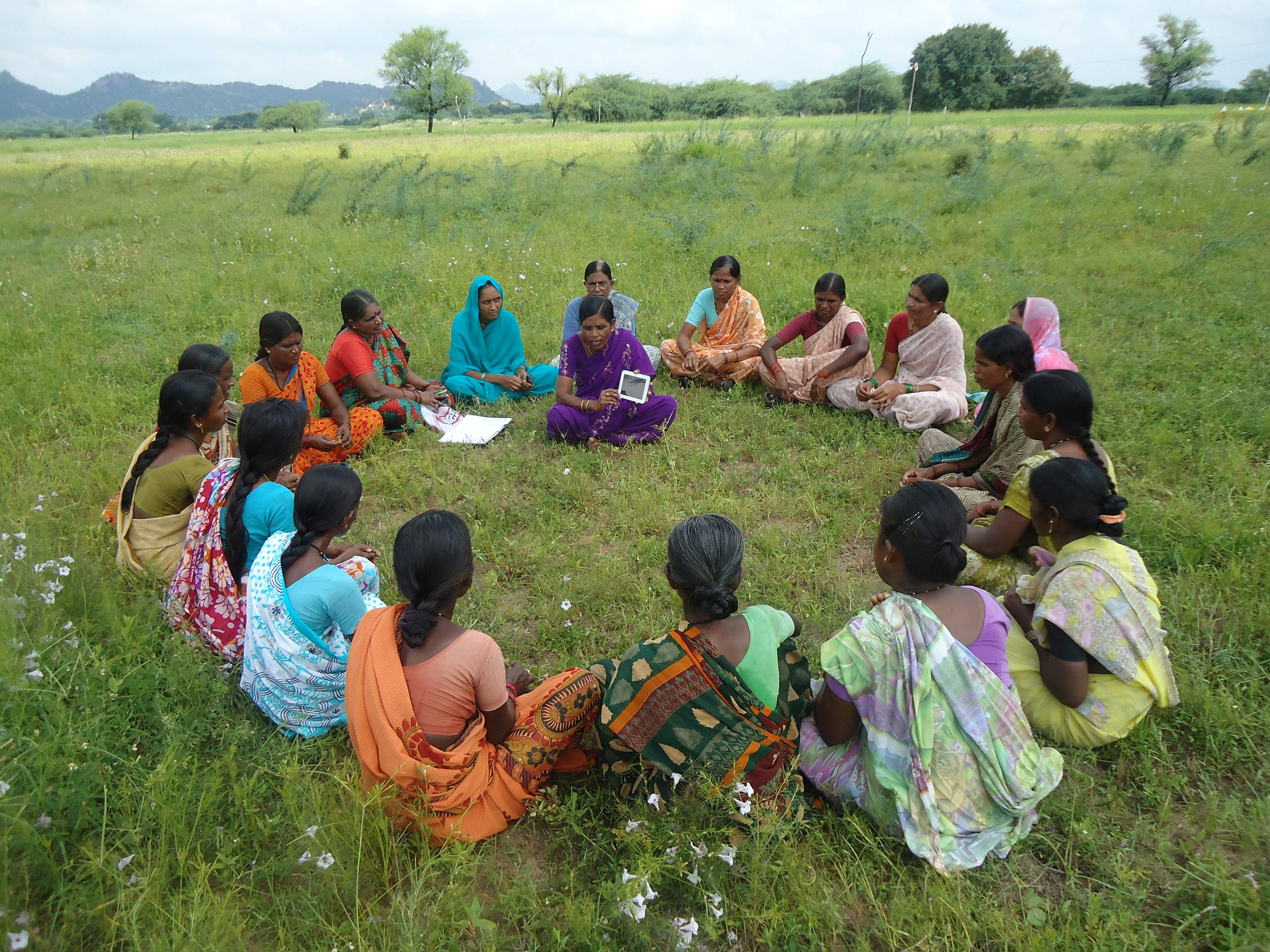 A woman trains others in the use of digital tools